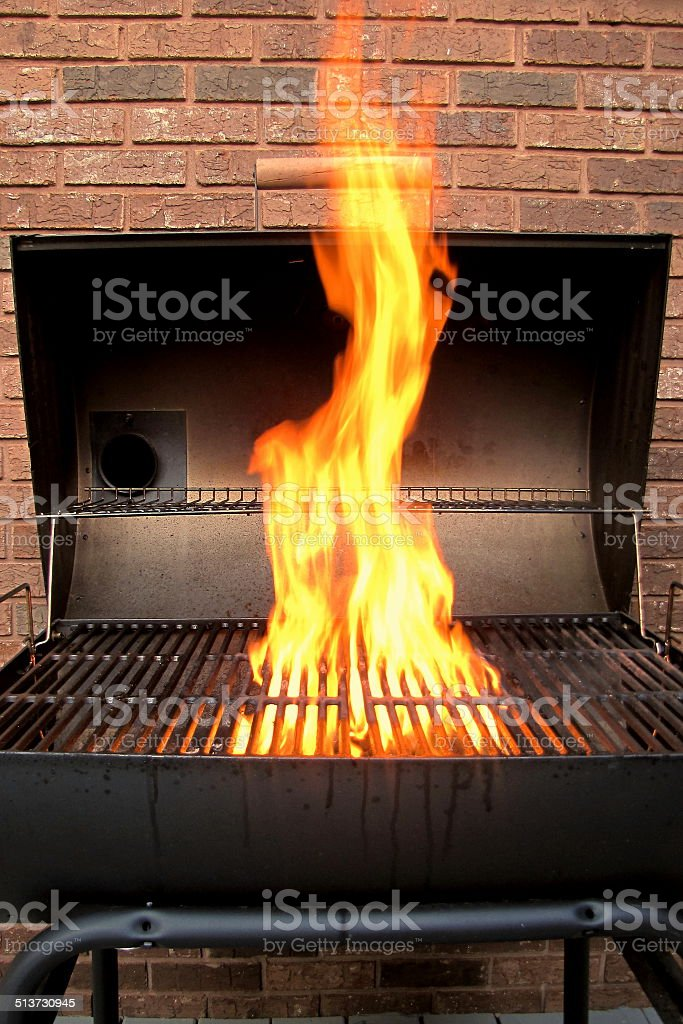 Charcoal grill starting up stock photo