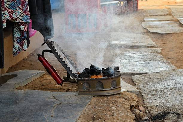 Charcoal iron still in use on Indian street stock photo