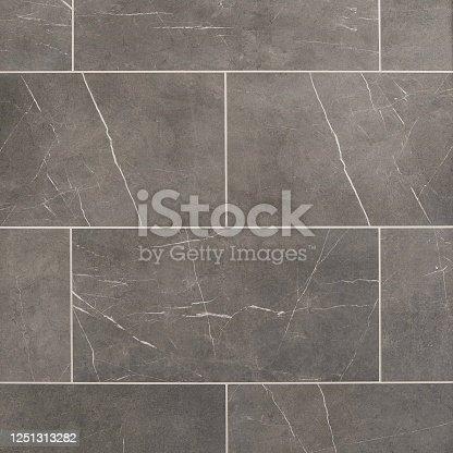 istock Charcoal porcelain tile seamless texture 1251313282