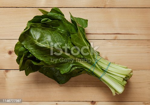 A bunch of Chard on wood.close up.