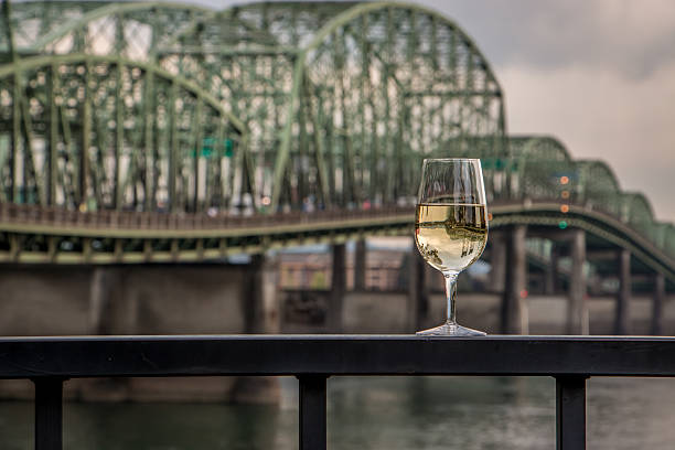Chardonnay Wine Glass Inverting Image Bridge Oregon Washington Portland Vancouver stock photo