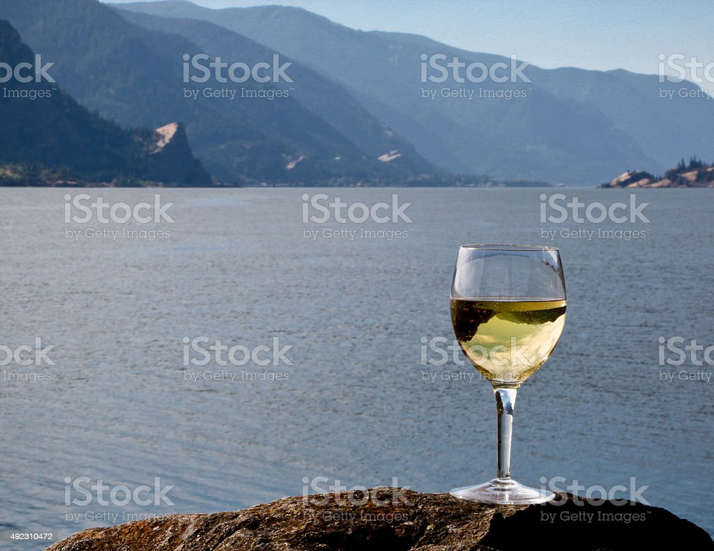 Chardonnay Wine Inverting Columbia River Gorge in Glass Washington Oregon stock photo