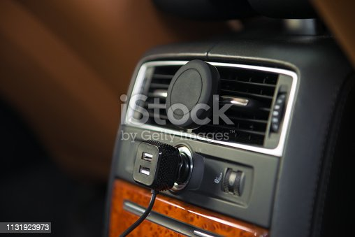 istock USB charger and magnet A/C mobile phone holder mount in luxury car rear seat 1131923973