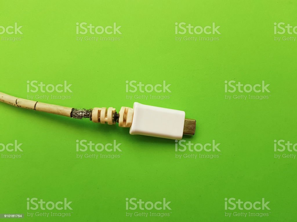 charger broken color background stock photo