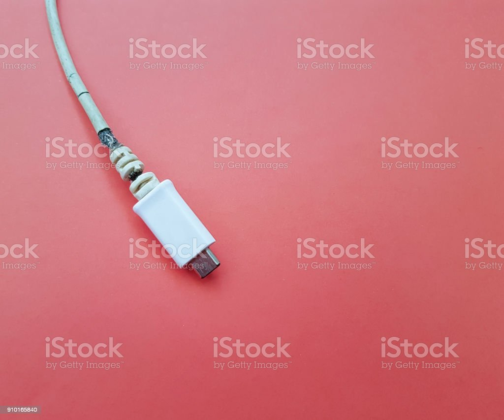 charger broken red background stock photo