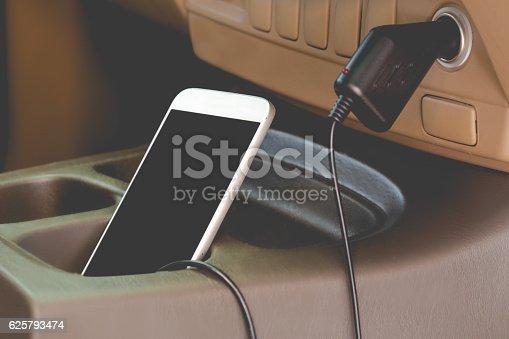 istock Charger plug phone on car 625793474