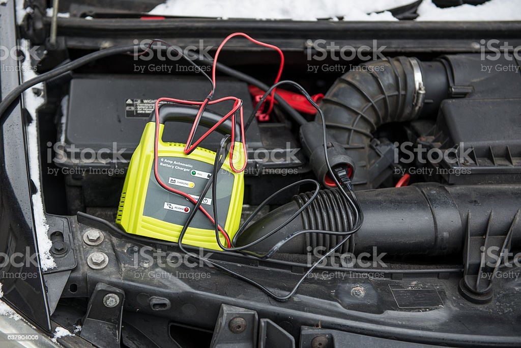 charging a car battery stock photo