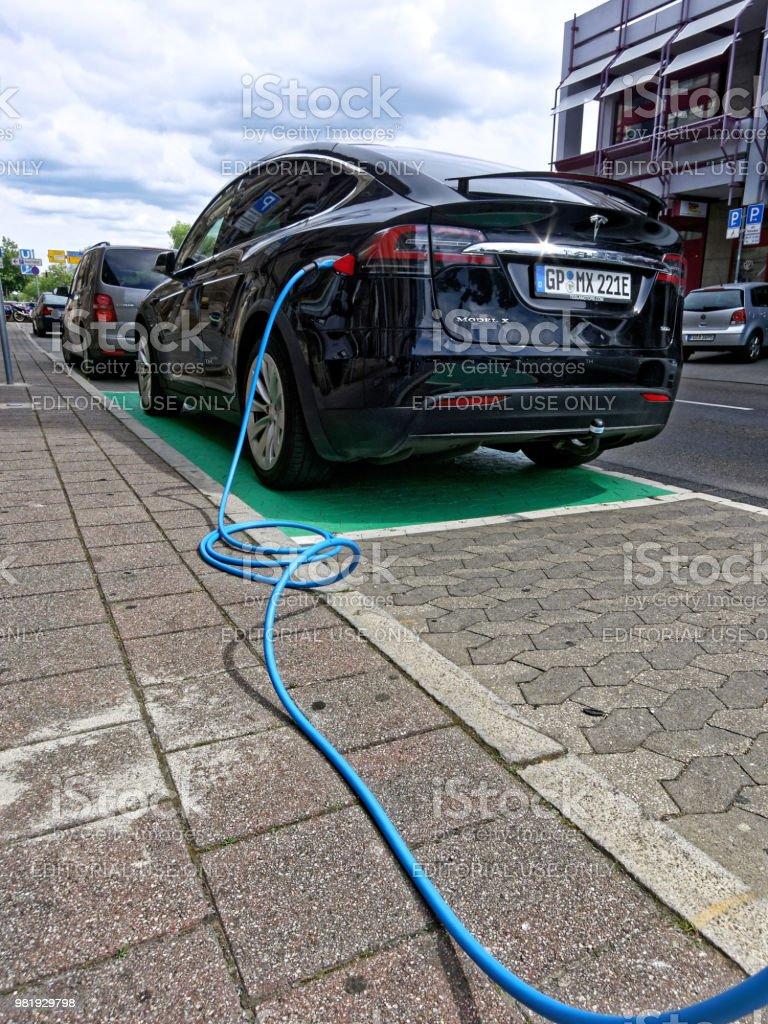 Charging a Tesla electric car - Model X stock photo