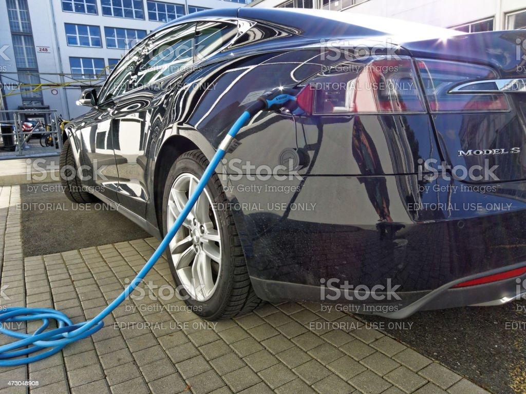 Charging a Tesla electric car stock photo