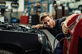 istock Charging air conditioning unit at auto repair shop! 1191768797
