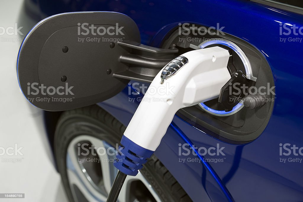 Charging an electric car close up royalty-free stock photo