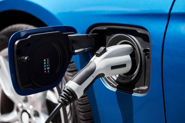 Charging an electric car or plug in hybrid Charging an electric car or plug in hybrid hybrid car stock pictures, royalty-free photos & images