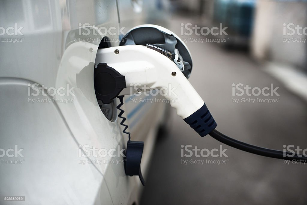 Charging an electric car with the power cable stock photo