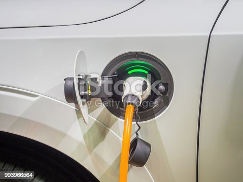 istock Charging an electric car with the power cable supply plugged in 993966564