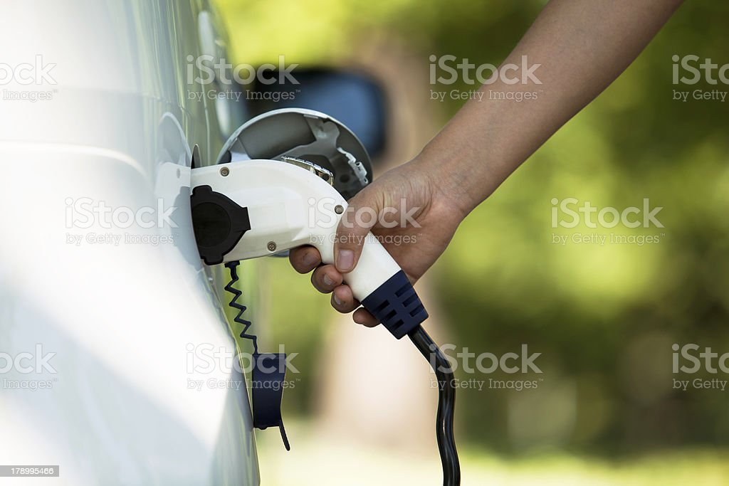 Charging battery of an electric car stock photo