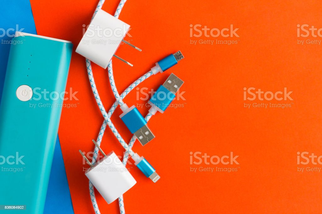 USB charging cables for smartphone and tablet in top view stock photo
