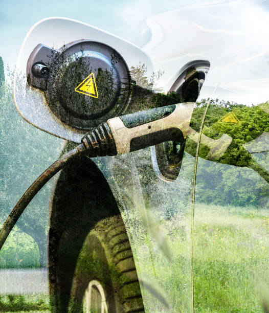charging electric car photomontage with nature background - automobile con biodiesel foto e immagini stock