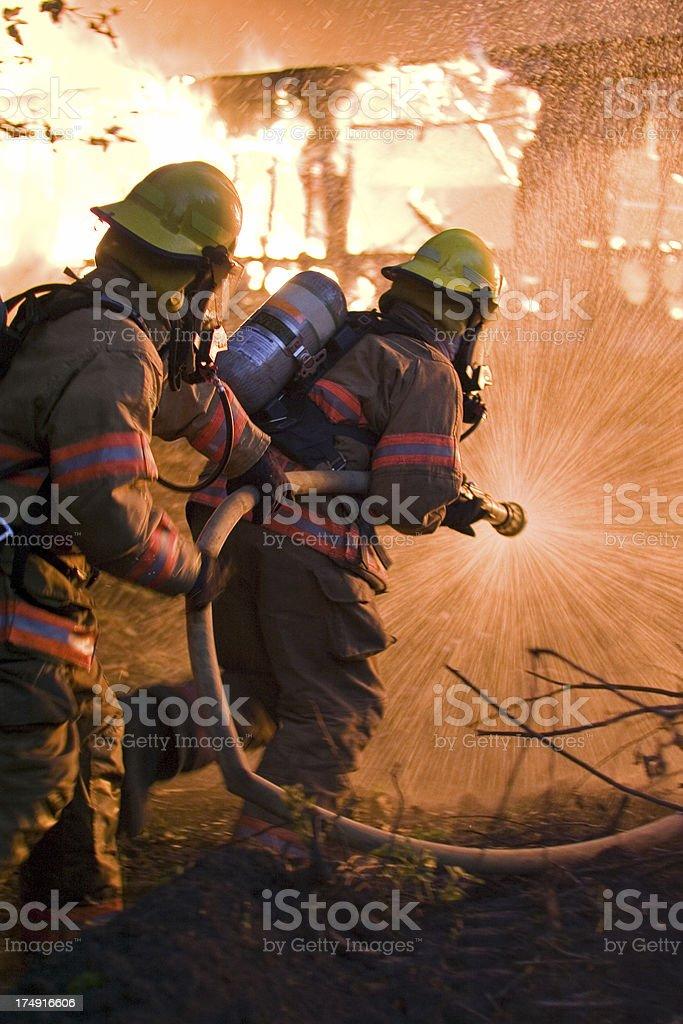Charging Firemen royalty-free stock photo