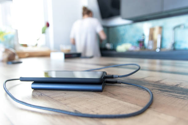 Charging phone in the kitchen stock photo