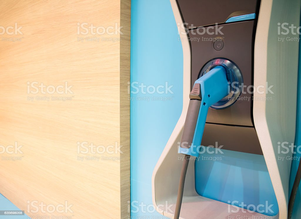 Charging Power To vehicles. Electric car. Plug in hybrid royalty-free stock photo