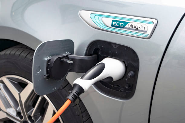 Charging process in Kia Optima plug-in vehicle Berlin, Germany - 11 April, 2019: Charging process in Kia Optima plug-in vehicle on the public charging station. This vehicle is on of the first popular sedan vehicles with plug-in hybrid technology in Europe. hybrid vehicle stock pictures, royalty-free photos & images