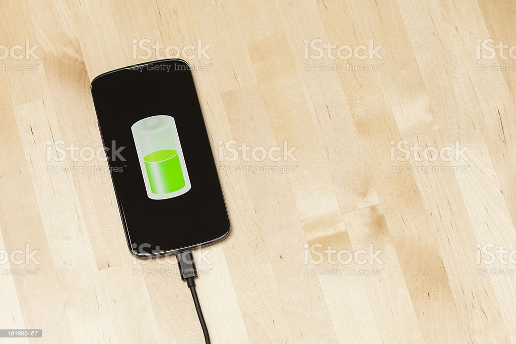 Charging smart phone royalty-free stock photo