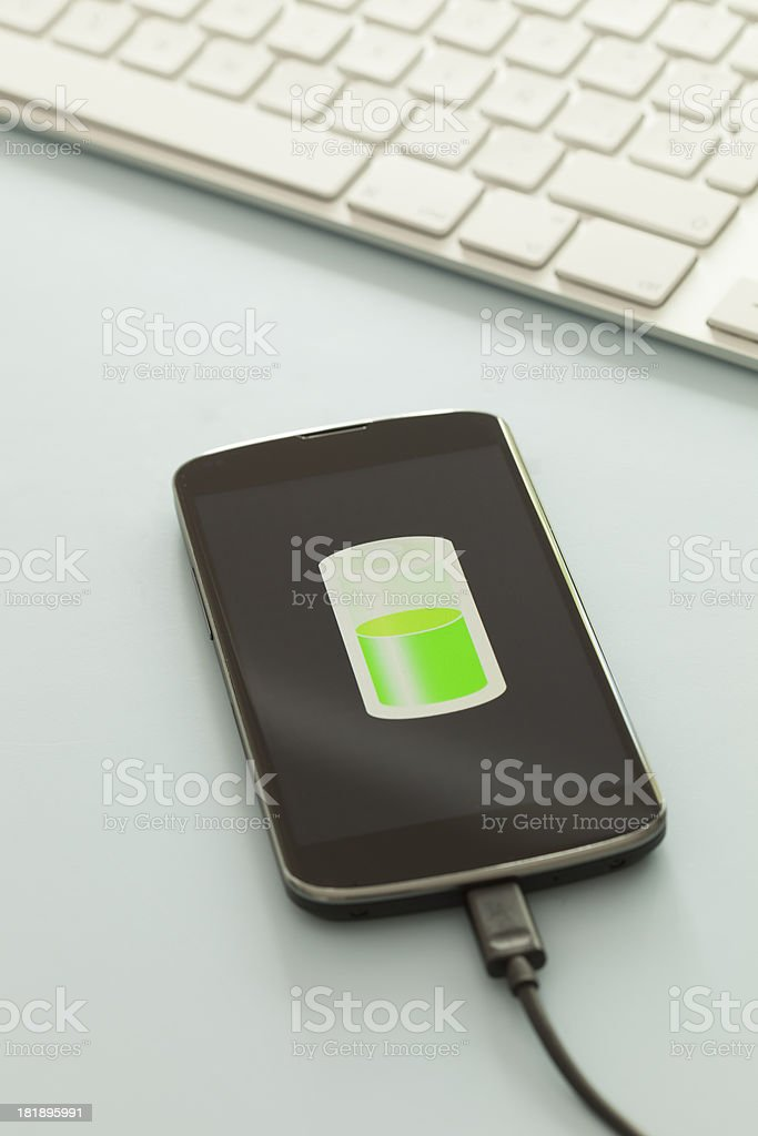 Charging smart phone royalty-free stock photo