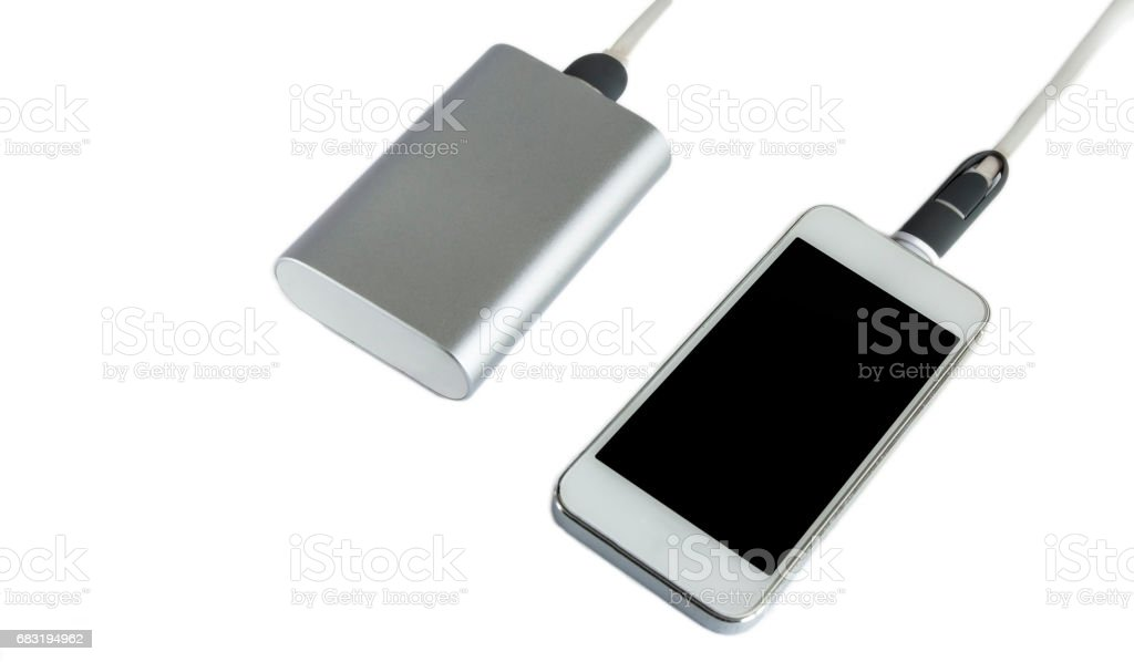 Charging smartphone with grey power bank ( portable external battery ) isolated on a white background royalty-free 스톡 사진