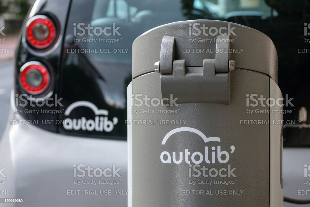 Charging station for electric car in Paris Autolib service. Detail on car and station stock photo