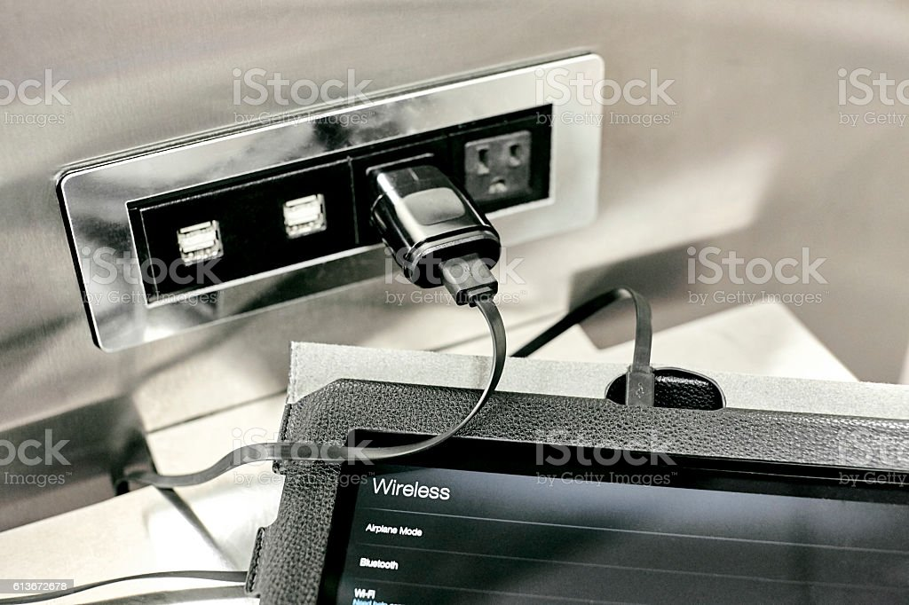 Charging Station with Tablet plugged In stock photo