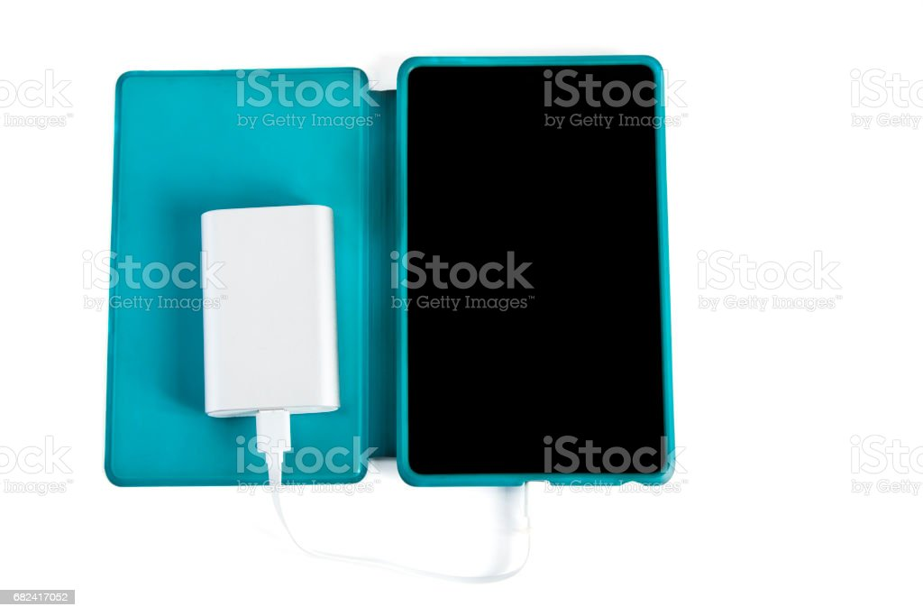 Charging tablet isolated on white background royalty-free stock photo