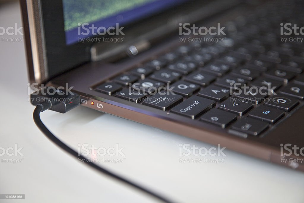 Charging Tablet or Laptop stock photo