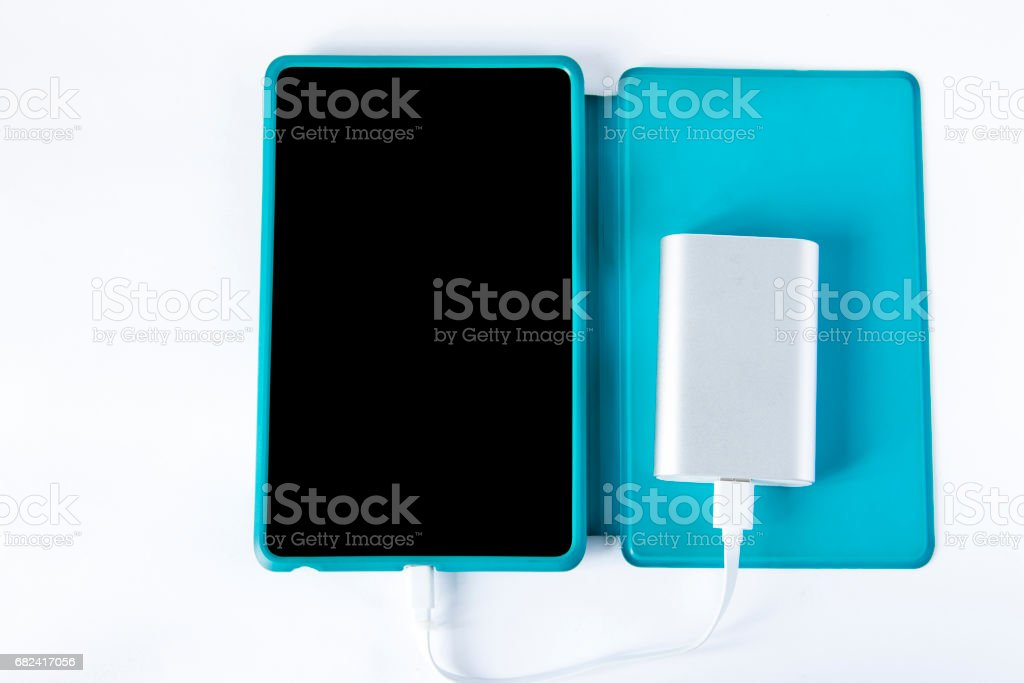 Charging tablet with portable external battery isolated royalty-free stock photo