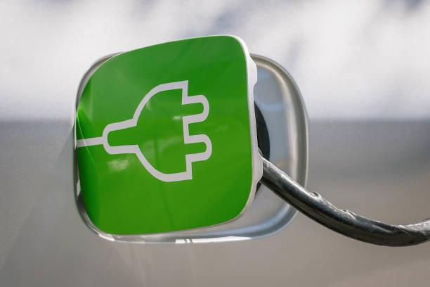charging the electric car in station. renewable energy concept - automobile con biodiesel foto e immagini stock