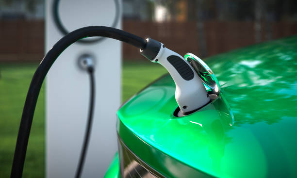 charging your ev at home with a charging plug close up 3d rendering - automobile con biodiesel foto e immagini stock