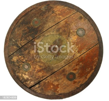 Imagination says its a chariot wheel or a rustic shield. Reality says its an old discus.