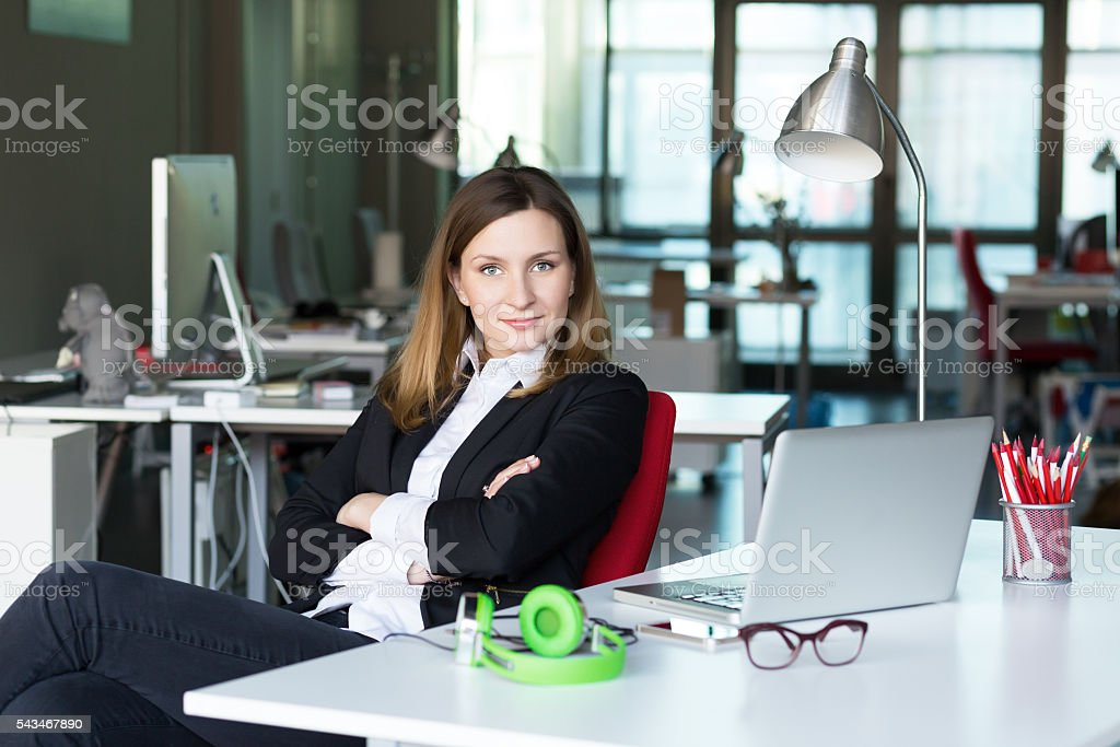 Charismatic Business Lady in official clothing in contemporary Office Interior stock photo