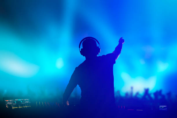 charismatic disc jockey at the turntable. - dance music stock pictures, royalty-free photos & images