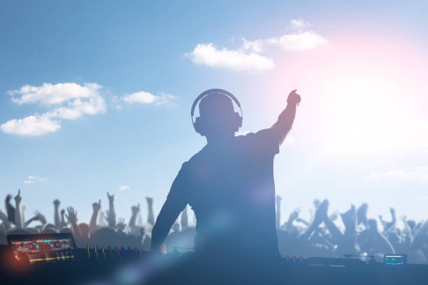 Charismatic disc jockey at the turntable. Charismatic disc jockey. Club, disco DJ playing and mixing music for crowd people. dj stock pictures, royalty-free photos & images