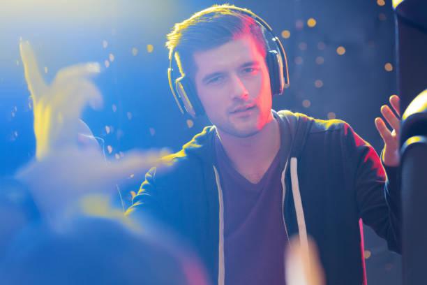 Charismatic dj wearing headphones stock photo