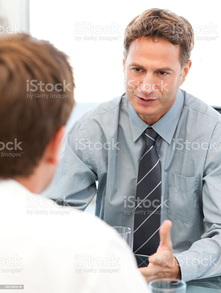 Charismatic manager during a meeting with an employee royalty-free stock photo