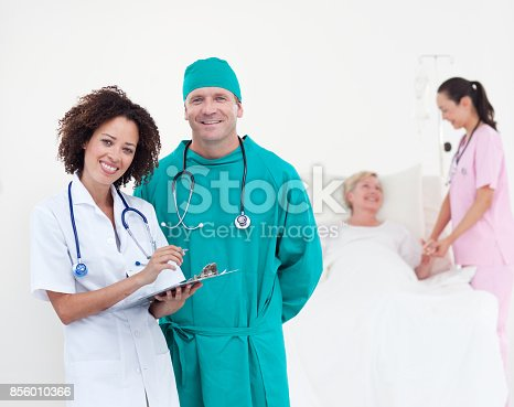 istock Charismatic team of doctors smiling at camera 856010366