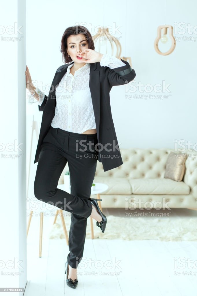 Charismatic woman dances near the wall. stock photo