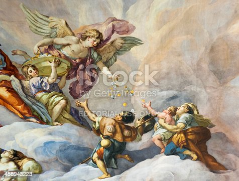 Vienna, Austria - January 9, 2012: Detail showing part of the 18th Century fresco on the interior of the main dome of Karlskirche (St. Charles's Church) in Vienna.  The fresco was painted by Johann Michael Rottmayr and Gaetano Fanti, and illustrates the Christian virtues of faith, hope and love.