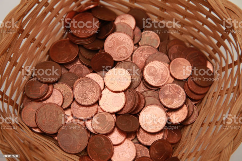 Charity donation Coins in a basket stock photo
