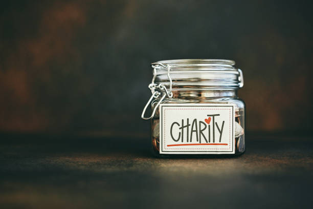 Charity jar filled with money stock photo