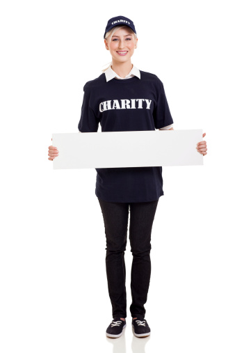 1166716628 istock photo charity worker holding blank banner 477677713