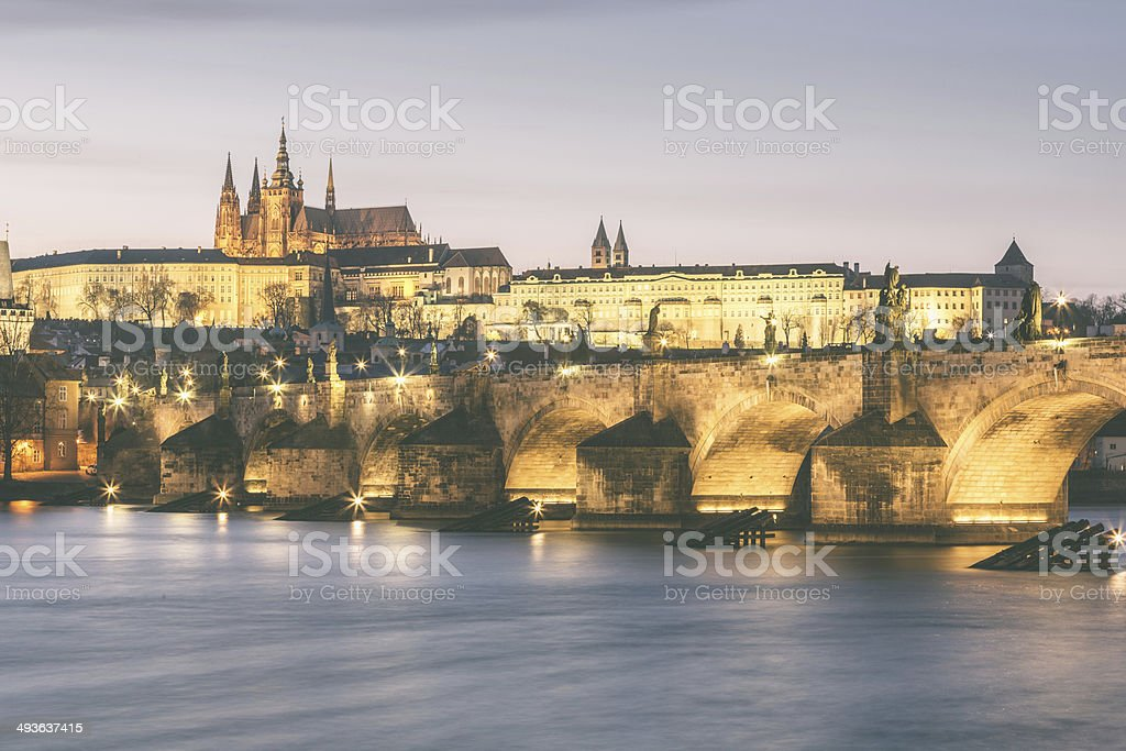 Charles Bridge and Castle in Prague at Dusk stock photo
