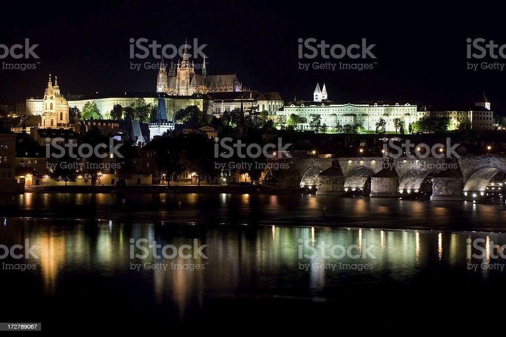 Charles bridge and Prague's castle illuminated at night royalty-free stock photo