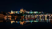 Night view of Charles Bridge and St. Vitus Cathedral  in Prague.